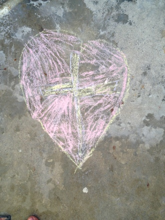 My daughter's favorite doddle - a heart with a cross inside.